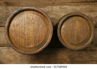 Old wine barrels on wooden background