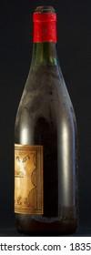 Old wine bottle - black background