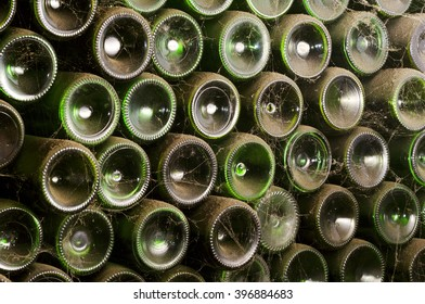 old wine bottles  in antique traditional wine cellar