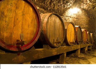An old wine cellar with oak barrels