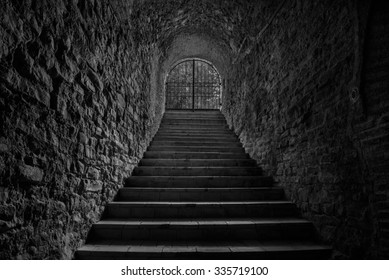 Old wine cellar tunnel entrance. Stairway leading to underground tunnel in black and white colors