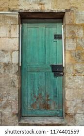 Old wodeen door and stone wall