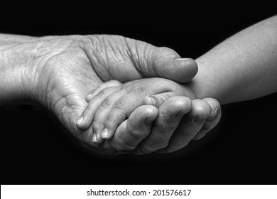 Old woman and baby hands