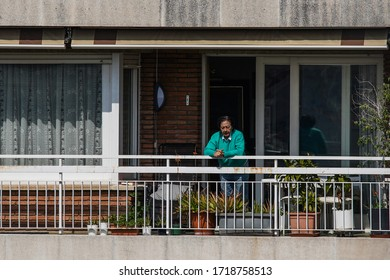 Old  woman in balcony during Coronavirus Lockdown to Boost Morale. March, 2020. Barcelona,Spain. Quedate en casa hashtag