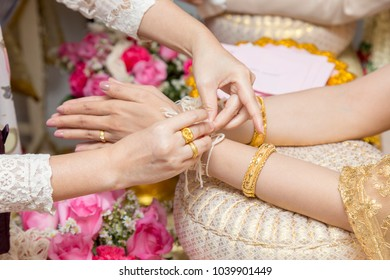 Old woman is blessing to couple in wedding  ceremony, wedding concept.