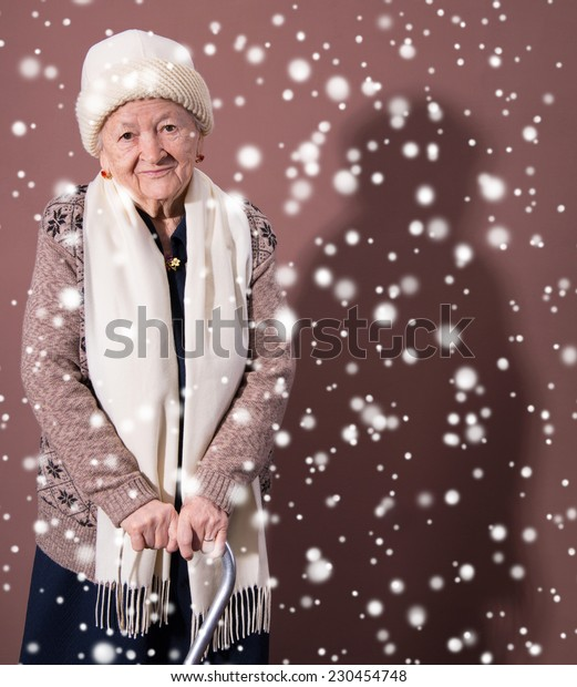 Old woman with a cane. Christmas and holidays concept