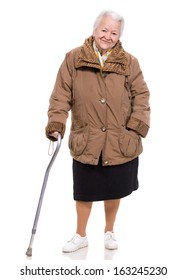 Old woman with a cane on a white background