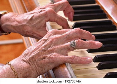 Old woman close up of hands  playing the piano