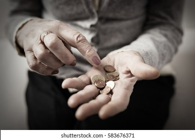 Old woman counting her retirement money