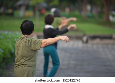 Old woman doing Tai Chi or Tai ji , Traditional Chinese martial arts for healthy life concept.