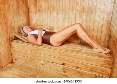 Old woman enjoys relaxing the spa holiday in the sauna at the spa hotel