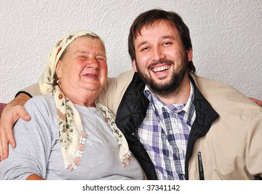 An old woman with good funny face and young man beside