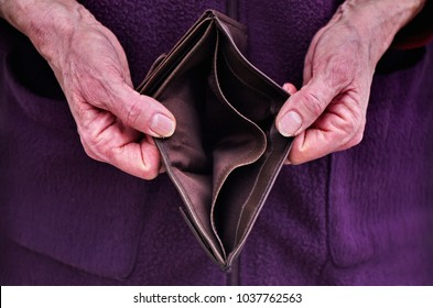 Old woman Hands holding open an empty wallet. Finance problems.