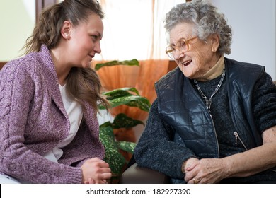 Old woman with her home caregiver