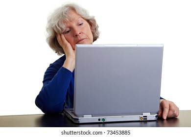 Old woman looking bored at her laptop