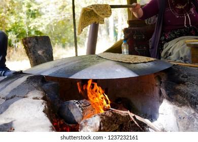 Old Woman making A Turkish specialty Gözleme/Gozleme Located in Cappadocia Turkey.