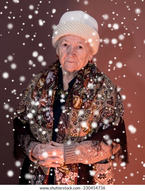 Old woman on brown background. Christmas and holidays concept