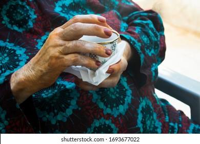 Old woman Palestinian coffee arabian coffee drink henna