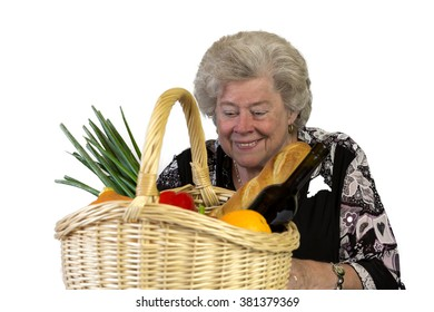 An old woman is pleased with her shopping basket with foods
