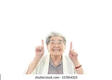 Old woman pointing