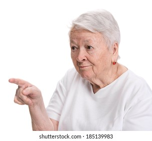 Old woman pointing on white background