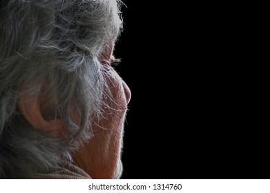 old woman portrait with natural light making her face glow with divine light and intensity
