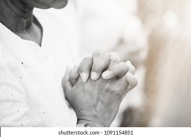 old woman praying and worship in church in sunday morning.Hands folded in prayer concept for faith, spirituality, worship and religion.black and white tone.