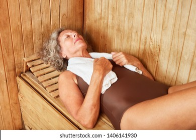 Old woman relaxes in the sauna or steam bath at the Wellness Hotel