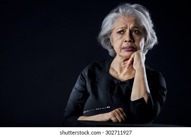 Old woman with a sad face