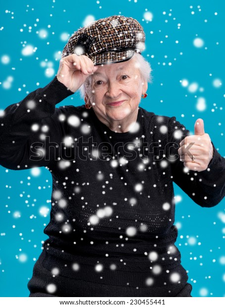 Old woman showing ok sign. Christmas and holidays concept