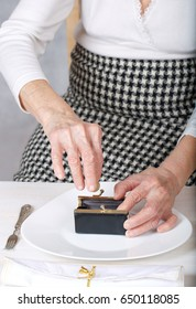 Old woman shows her empty lunch plate.