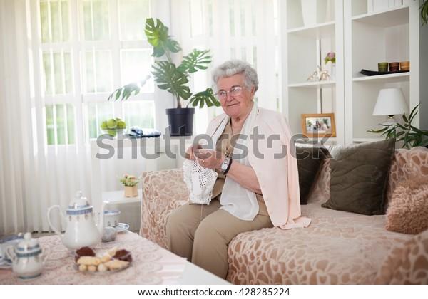 Old Woman Sitting On Sofa Crochet Stock Photo Edit Now 428285224
