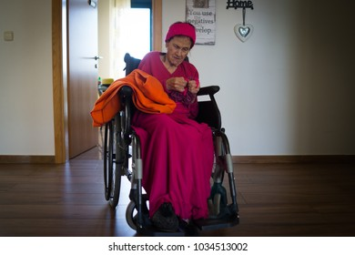old woman sitting on wheelchair in the room