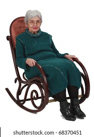 Old woman sitting on a wooden rocking chair isolated against a white background.