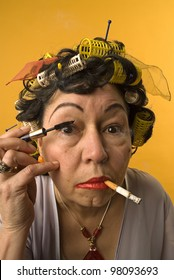 Old woman smoking and applying make up
