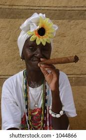 old woman smoking a cigar