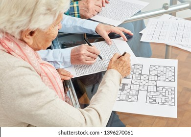 Old woman solves sudoku puzzles as memory training