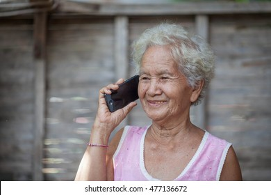 Old woman talking on a smartphone