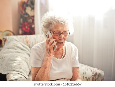 old woman  talking of the phone