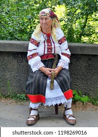 an old woman in traditional costume in Voronet Suceava county- Romania 24.Jul.2016