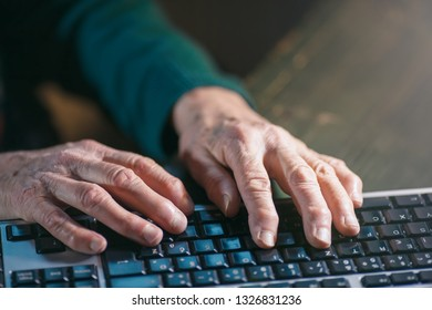 old woman using a computer keyboard