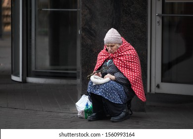 old woman waiting for some money