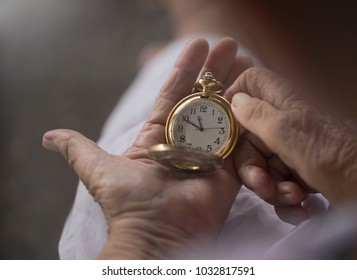 Old woman watching the old clock, lifespan