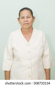 An old woman wearing a white shirt