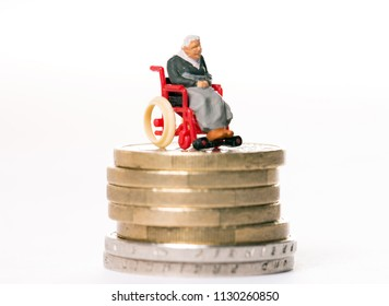 old woman in wheelchair on a money pile