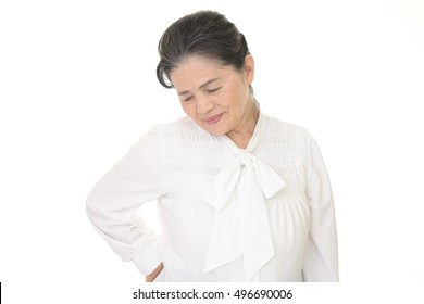 Old woman who has a back pain