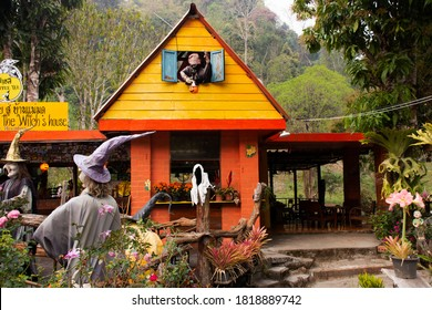 Old woman witch figurine and haunted house cafe coffee shop in garden outdoor on forest mountain at pai city hill valley on February 28, 2020 in Mae Hong Son, Thailand