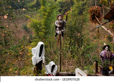 Old woman witch figurine and haunted house cafe coffee shop in garden outdoor on forest mountain at pai city hill valley in Mae Hong Son, Thailand