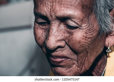 The old woman's felling lonely. ,she's senior woman in family and the elderly.
