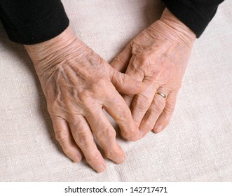 Old woman's hands on a white background